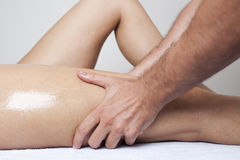 Thigh massage Royalty Free Stock Images