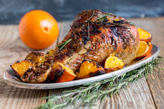 Thigh of turkey baked with oranges. Stock Images