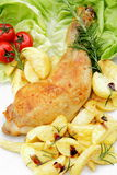 Thighs of chicken on lettuce leaves white backgrou Royalty Free Stock Photo