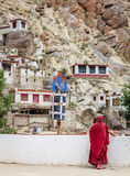 Thiksay Buddhist Monastery. Ladakh, India - July 10, 2016: Buddhist monk in traditional robe at Thiksay monastery in Ladakh, Kashmir, India Royalty Free Stock Images