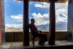 Monk resting in Thikse gompa in Ladakh region, India royalty free stock photo