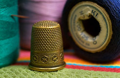 Thimble. Closeup of vintage thimble and spools of thread Royalty Free Stock Photography