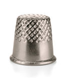 Thimble. Metal sewing thimble isolated on white Royalty Free Stock Photo