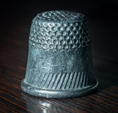 Thimble. Grunge thimble on the desk Stock Photo