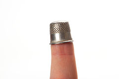 Thimble on middle finger, closeup Royalty Free Stock Photos