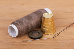 Thimble and needle Royalty Free Stock Image