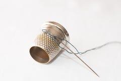 Thimble, needle, tape measure Stock Photo