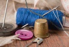 Thimble and needles Stock Image