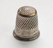 Thimble. Old worn-out copper thimble Stock Photography