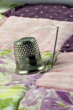Thimble and patchwork quilt Royalty Free Stock Photos