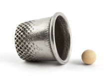 Thimble and pea Royalty Free Stock Photography