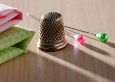 Thimble and pins Stock Photo