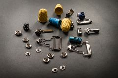 Thimble and sewing pins on dark royalty free stock image