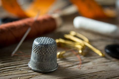 Thimble and sewing Stock Photo
