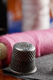Thimble and spools Royalty Free Stock Image
