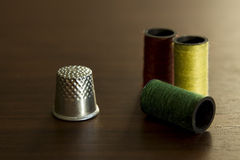 Thimble and thread Royalty Free Stock Photos