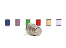 Thimble and Thread. Thimble with thread in the background Royalty Free Stock Images