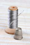 Thimble and Thread Spool Royalty Free Stock Image