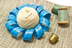 Thimble, yarn and spools of thread Stock Photos