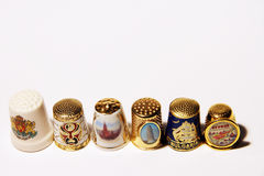Thimbles. Collection of thimbles of the different countries Stock Images