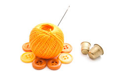Thimbles, ball of yarn and buttons Stock Photo