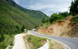 Mountain scenery in Thimphu, Bhutan. Thimphu, Bhutan - Aug 29, 2015. Mountain road at sunny day in Thimphu, Bhutan. Bhutan is located on the southern slopes of Stock Images