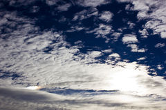 Thin altocumulus clouds Stock Photo