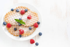 Thin Belgian waffles with fresh berries, top view Stock Photo