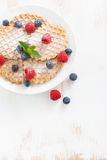 Thin Belgian waffles with fresh berries, top view, vertical Royalty Free Stock Photo