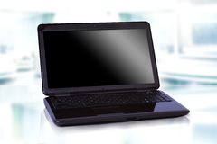 Thin black laptop Stock Images
