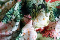 Thin bright colourful fabric in soft folds. Thin bright colorful fabric in soft folds Royalty Free Stock Images