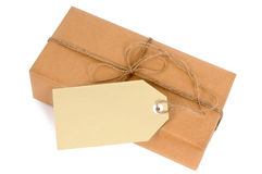 Thin brown paper package with string and manila label isolated, copy space Royalty Free Stock Photo