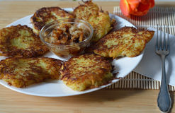 Thin brown potato hashbrown pancakes with onion and lard Stock Image