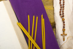 Thin candles on purple cloth used in religion Royalty Free Stock Images