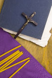 Thin candles on purple cloth used in religion Stock Photo