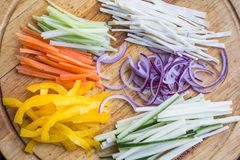 Thin chopped sticks of vegetables for cooking, zucchini, carrot Royalty Free Stock Image