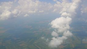 Thin clouds and fog hanging over fields high in sky, saving atmosphere, ecology. Stock footage stock footage