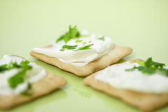 Thin crackers with cream cheese Stock Photography