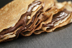 Thin crepes or blinis with chocolate cream on Royalty Free Stock Photography
