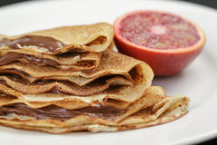 Thin crepes or blinis with chocolate cream on stock images