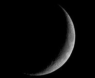 Thin crescent moon. A four-day-old Moon, photographed on 2004-06-21 in its crescent phase, photographed through a 0.2-metre telescope royalty free stock photography