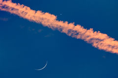 Thin Crescent Moon and Venus. Conjunction in an airplane jet streem Stock Photo