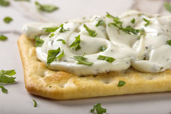 Thin crispy crackers with cream cheese and parsley Stock Image