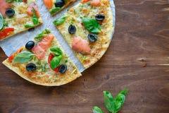 Thin crispy pizza with fish Stock Image
