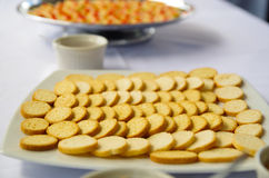 Thin crunchy toasted baguette slices stacked up on white plate.  Royalty Free Stock Images