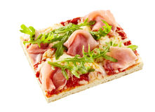 Thin crust arugula and ham Italian pizza Royalty Free Stock Images