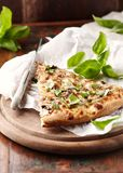 Thin-crust pizza topped with fresh basil leaves. Slice of pizza. Home made food. Italian vegetarian pizz royalty free stock photography