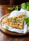 Thin-crust pizza topped with fresh basil leaves. Slice of pizza. Home made food. Italian vegetarian pizz stock photography