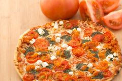 Thin Crust Traditional Pizza Stock Photography
