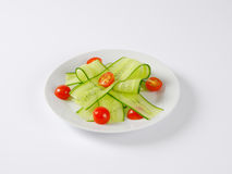 Thin cucumber slices and cherry tomatoes Royalty Free Stock Image
